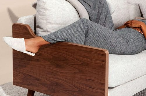 person resting on couch